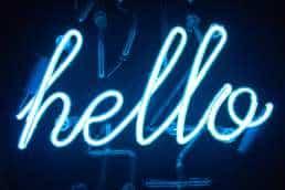 Hello written in blue neon lights
