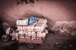 Cart piled high with bundles