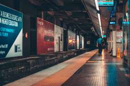 Man walking next to empty metro station