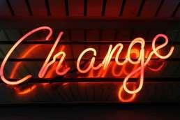 word 'change' written in red neon lights