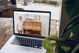 Laptop displaying a designer's website