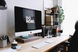 Desktop computer with Do More written on screen