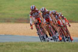 Group of orange-outfitted bicyclists