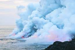 Lava entering ocean and steam rising