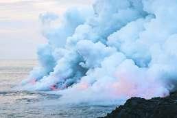 Lava entering ocean and steam rising