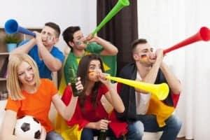 Soccer fans blowing vuvuzela