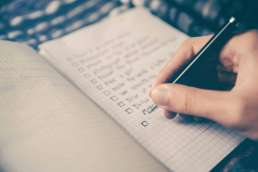 Person writing to-do list