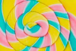 Pink yellow and blue lollipop