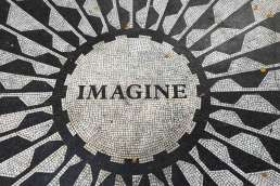 Imagine written with black and white tile along with a pattern