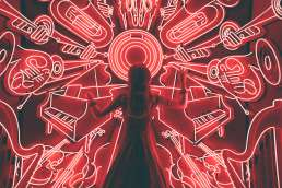 Woman standing in front of neon red lights formed like musical instruments