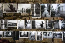 Various black and white photos from a city strung up