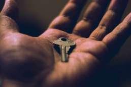Hand holding key