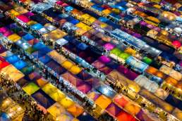 Colorful tents lit up at night