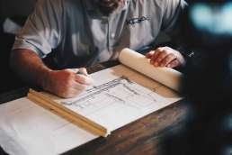 Man working on architectural plans