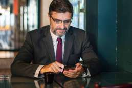 Man in suit on phone