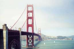 The Golden Gate bridge, the river and the land on the other side of the bridge