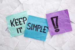 Blue and purple sticky notes that say 'Keep it simple!'