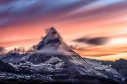 Snowy mountain against sunrise