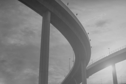 Grayscale photo of diverging highways