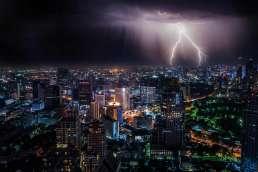 Lightning striking city at night