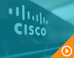 Close-up photo of Cisco logo on one of their products behind a blue transparency with a white play button on an orange triangle in the bottom right corner