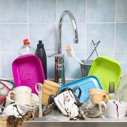 Kitchen utensils in sink need a wash