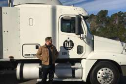 Man standing in front of white semi truck