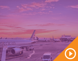 Airport loading dock with sunset in the background behind purple overlay