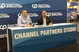 Two men presenting at Channel Partners Evolution studio booth