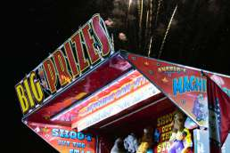 Colorful carnival game with stuffed toys promising big prizes