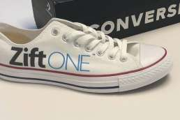 White ZiftONE sneaker in front of box