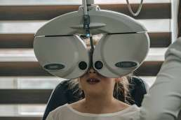 Girl at doctor's office getting her eyes examined